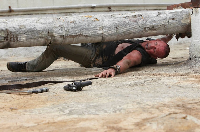 The Walking Dead Michael Rooker reaching for a saw